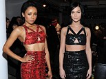 Kat Graham and Leigh Lezark arrive in same midriff-baring fetish-style look for Jeremy Scott show... but luckily opt for different colours