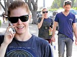 Chasing Amy! Adams struggles to keep up with artist fiance Darren Le Gallo as they leave the gym in Beverly Hills