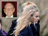 Windswept Cressida Bonas braves the elements for a moving farewell to stepfather Christopher Shaw