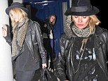 A model example: Kate Moss picks up Cara Delevingne for a night out... looking remarkably similar as they go make-up free in matching leather jackets