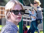 Swinging good time! January Jones enjoys an action-filled day at the park with her son Xander