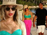 Marital bliss! Beyonce sizzles in green bikini top and pink trousers during hand-holding stroll on the beach with husband Jay Z