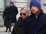 A bit chilly! Lara and Sam rug up to stroll in NYC