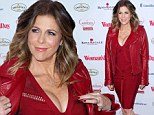 They're Big! Tom Hanks' wife Rita Wilson flaunts her cleavage in red dress with a daringly plunging neckline