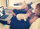Multi-tasking mom: Rachel Zoe was seen cradling her two-month-old son Kaius Jagger on her chest as she worked from home, watching a New York Fashion Week show on her laptop in an Instagram shot posted on Tuesday