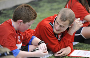 David Wheater gets down to business with a young fan at Eston - Photo-North News and Photos