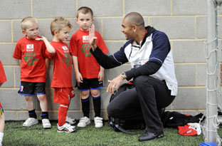 Give me five! - Afonso Alves with young Boro fans at Eston - Photo-North News and Pictures