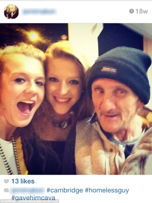 Unfunny: These young women took a photo of themselves with a homeless man