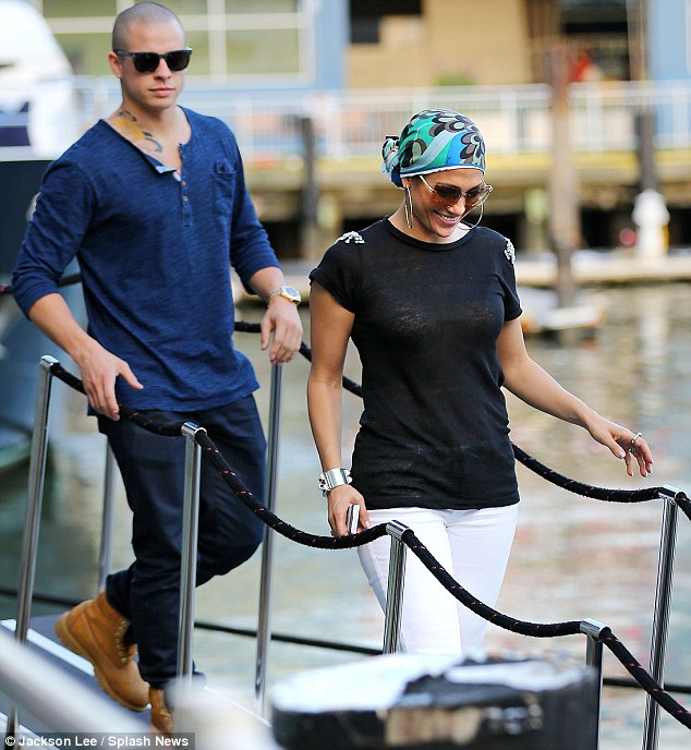 In good spirits: Jennifer couldn't stop smiling as she led her toyboy off the boat