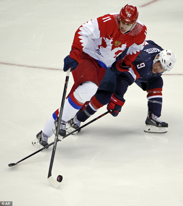 Russia forward Yevgeni Malkin and USA forward Zach Parise battle for the puck in the third period.The U.S.-Russia match-up was one of the most anticipated matches at the Sochi winter games