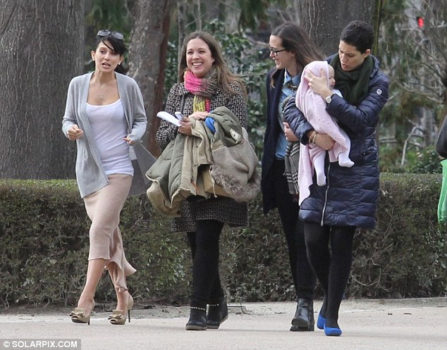 Entourage: Mrs Alec Baldwin was accompanied by a few helping hands and a nanny to watch over Carmen while she worked