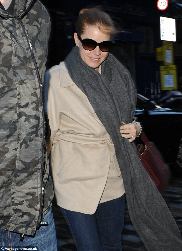 Welcome: Amy makes her way into her central London hotel ahead of her appearance at the 67th British  Academy Film Awards on Sunday evening