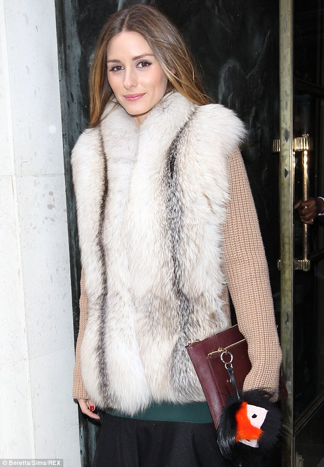 Wrapped up warm: The star was trudging through snow at last week's New York Fashion Week, so was well prepared for London's bitter weather