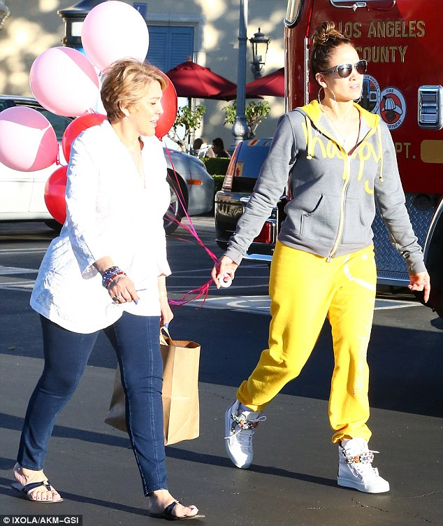 Look-a-likes: The pair demonstrated a similar gait as they made their way back to the car
