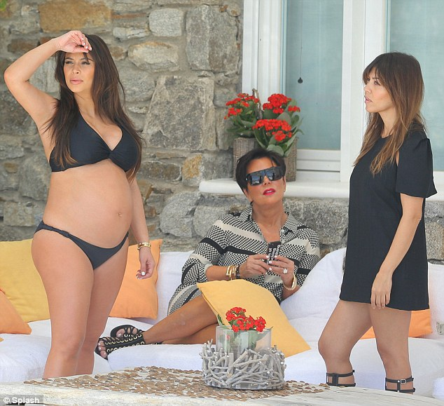 Beauty in black: Kim also wore a black bikini as she enjoyed some time with her mother Kris Jenner and her sister Kourtney