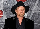 Just in time: Trace Adkins is reported to have made it to his father Aaron's bedside before he died, pictured in Las Vegas in December 2012