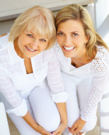 Smiling mother with happy, middle-aged daughter
