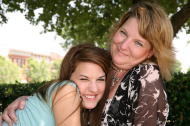 College girl embracing mom on parent's day