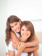 Cute girl hugging her mother.