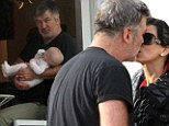Alec and Hilaria Baldwin share a tender kiss during Hamptons getaway before enjoying cosy family breakfast with daughter Carmen