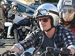 Licence to thrill! Josh Hutcherson takes mystery brunette beauty for a ride on his motorcycle