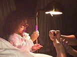 'Beauty school starts now!' Mariah Carey enlists daughter Monroe to hold heat lamp over her toenails during pedicure