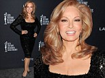 Still got it! Raquel Welch, 73, proves you can be a sex symbol at any age in a skin tight dress
