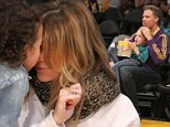 Making for the cutest Kiss Cam ever! Ellen Pompeo and Will Ferrell cuddle up with their four-year-old children at Lakers game
