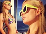 'Another day in Paradise': Paris Hilton poses in tiny string bikini on the balcony of her Miami hotel room