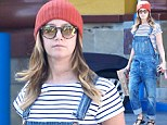 Throwback Sunday? Ashley Tisdale flashes her tummy as she brings back the 90s in dungarees and a crop top