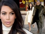 Love is in the air! Kim Kardashian covers up in ivory while holding Kanye West's hand at lunch