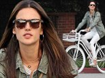 Angelic Alessandra Ambrosio wears white outfit that matches her bike as she takes a ride in the sunshine