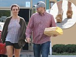 Do you want a piece of me? Britney Spears added an edge to her casual look with a pair of gold spiked heels