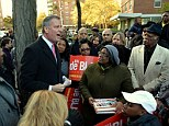 New York City Democratic mayoral candidate Bill de Blasio speaks to volunteers a he campaigns in the Queens borough of New York