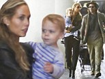 My little travel baby! Elizabeth Berkley stays glued to her son Sky Cole ahead of family flight out of LA with husband Greg Lauren