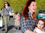 Fun-loving: Alyson Hannigan takes Satyana and Keeva to a birthday party at the Santa Monica Pier with husband Alexis Denisof