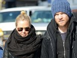 Arrested: Sam Worthington with Lara Bingle in New York last week