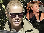 We didn't know you were friends! Make-up free Gwyneth Paltrow piles into her car after attending a party at Charlize Theron's home