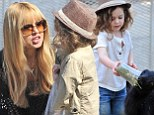 Mom's little animal! Rachel Zoe's adorable son Skyler makes some four-legged friends at the farmers market