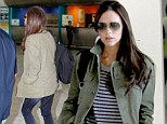 Not so Posh! Victoria Beckham does casual in a striped top, skinny jeans and a backpack as she touches down in South Africa