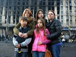 Mom and kids in a war zone: Lisa Bundy (right) with her new adopted children (top left across) Nastia, 16, Karina, 14, Max, 11 and 9-year-old was half-a-mile from the protests