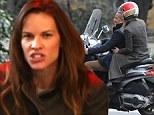 Friends in high (fashion) places! Hilary Swank enjoys coffee with Ferragamo's Andrea Tremolada... before hopping on his scooter in Milan