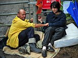 Natalie Hynde and her friend Simon Medhurst glue themselves together during a demonstration outside the entrance of a drill site operated by Cuadrilla Resources Ltd in Balcombe, southern England