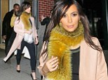 Kim Kardashian takes foxy lady look too far with bizarre furry scarf as she heads out on date with Kanye West