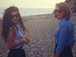Chillin' at the beach: Taylor Swift posted this picture of herself and new best friend Lorde at an undisclosed location. Her caption simply read: Bare feet in the sand on a Saturday...'