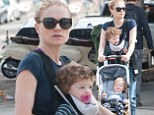 She's got this motherhood caper down-pat! Anna Paquin expertly transports her giggling twins through LA