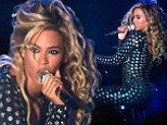 Rocking it: Beyonce donned a tight black bodysuit with shiny studding on Monday while performing in Birmingham, UK
