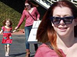 Still smiling! Seemingly perpetually happy actress Alyson Hannigan beams as she walks with daughter despite How I Met Your Mother coming to an end