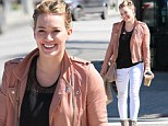 Hilary Duff shows off her toned legs in ripped skinny jeans
