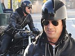 Hell bent for leather! Rough and ready Justin Theroux dons biker jacket before showing off his chopper in Los Angeles